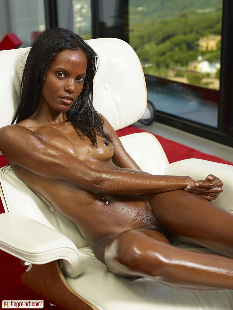 nude skinny black girl in a chair