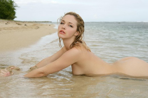 Alissa White lays naked in ocean